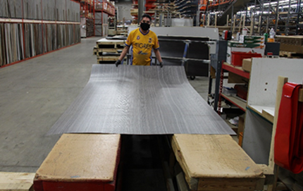 Laminate being rolled
